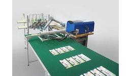 Roboteranlage zum Verkleben von Prospekten